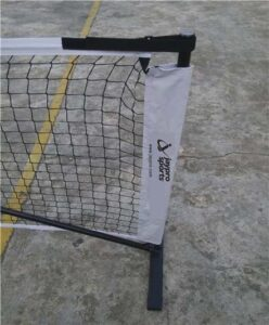 Portable Pickleball Net Set on cement surface